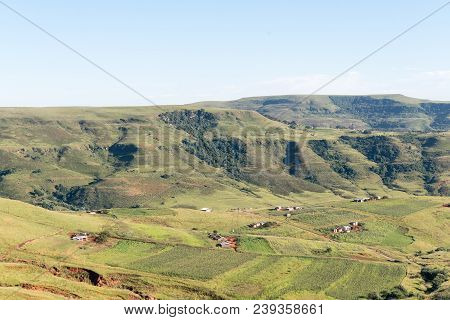 An Aerial View Of Farms On The Road To Injisuthi In The Kwazulu-natal Drakensberg. Houses And Corn F