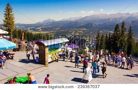 Zakopane, Poland: Aug 27, 2016: Beautiful View From Gubalowka Park. High Tatra Mountains In The Dist