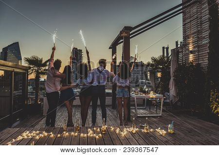 Friends Partying On A Rooftop