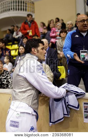 ST. PETERSBURG, RUSSIA - MAY 5, 2018: Andrea Cassara, Italy at referee desk during quarter-final of Fencing World Cup Saint-Petersburg Foil. This annual tournament is hold in 44th time