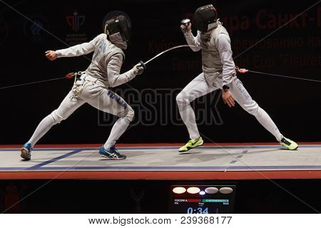 ST. PETERSBURG, RUSSIA - MAY 5, 2018: Alessio Foconi, Italy (left) vs Alexey Cheremisinov, Russia in semi-final of Fencing World Cup Saint-Petersburg Foil. Foconi won the fight 15-9