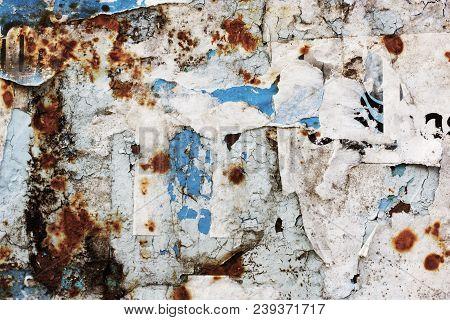 Old, Torn Bulletin Board. Street Empty Public Billboard, Blue Dirty Wall With Rust. Bright Colorful