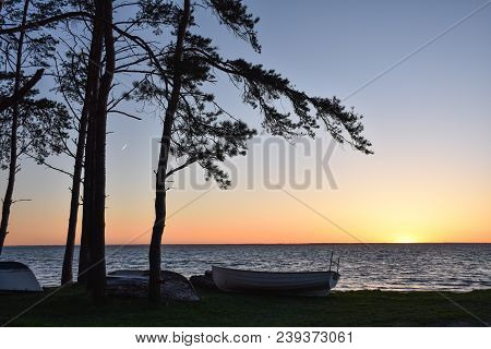Sunset By A Coast With Rowing Boats At The Swedish Island Oland