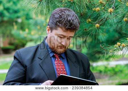Cropped Portrait Of A Mature Businessman Working On His Tablet Middle Aged Man Holding Touchpad