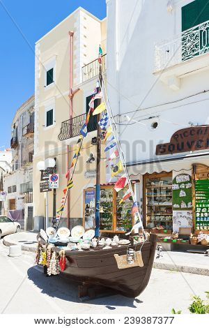 Vieste, Apulia, Italy - May 2017 - Sailing Ship Filled With Souvenirs In Front Of A Shop