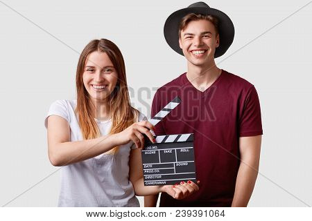 Two Successful Young Female And Male Famous Producers Or Directors Hold Film Clapper, Participate In