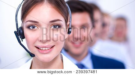 Businesswoman With Headset Smiling At Camera In Call Center.