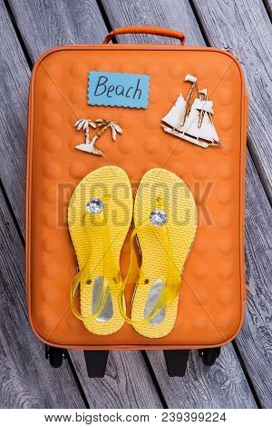 Beach Stuff, Flat Lay. Orange Suitcase And Yellow Luxury Flip-flops With Brilliants.