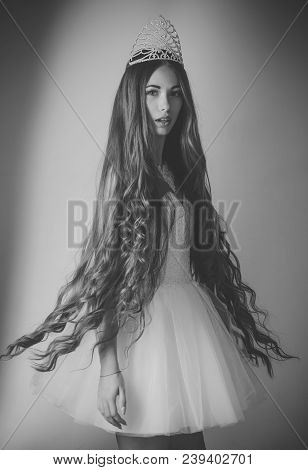 Woman With Long Hair White Dress And Crown. Beauty Salon And Wedding Fashion. Hairdresser And Cosmet