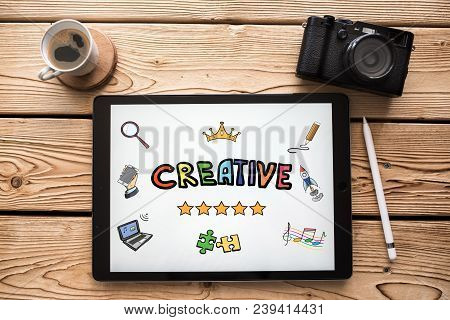 Creativity Concept On Digital Tablet With Various Hand Drawn Doodle Icons