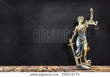 Statue Of Lady Justice With Black Board  Background