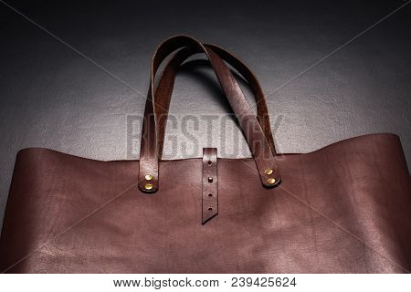 Elegant Luxury Brown Leather Bag Black Background Rich Accessories One Object Flat Lay Top View Sale