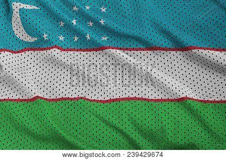 Uzbekistan flag printed on a polyester nylon sportswear mesh fabric with some folds poster