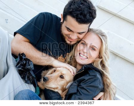 loving beautiful young couple with pet dog happy family poster