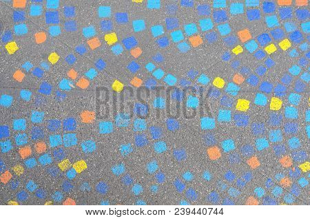 Painted Brightly Colored Mosaic Pattern With Geometric Squares On A Sidewalk In A Full Frame View