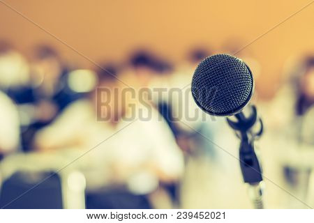 Microphone Voice Speaker With Audiences Or Students In Seminar Classroom, Lecture Hall Or Conference