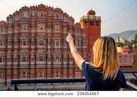 Back View Beautiful Young Woman Points To Hawa Mahal In Jaipur, Rajastan. Travel Concept In India