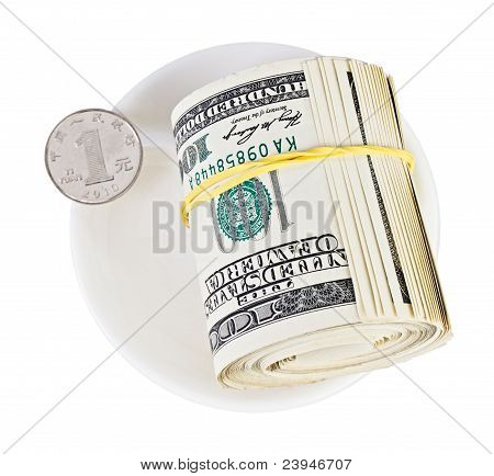 Many Us Dollars Rolled Up Versus One Chinese Yuan Coin On White Plate, Currency Concept Photo