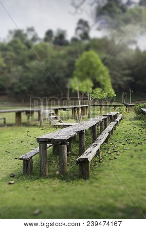 Outdoor Wooden Furniture In Field, Stock Photo