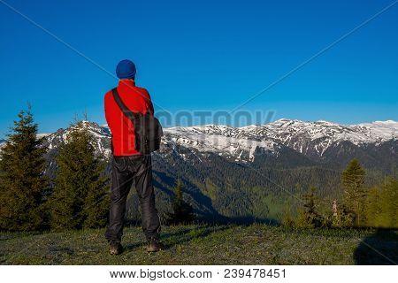 Adventurer, Photographer Is Standing On The Mountain Slope, Admiring The Stunning Mountain Range, Co
