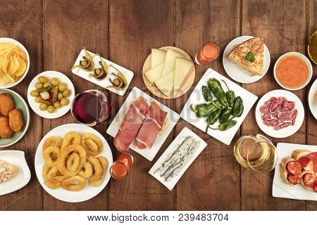 An Overhead Photo Of An Assortment Of Spanish Tapas Food, Shot From The Top On A Dark Rustic Backgro