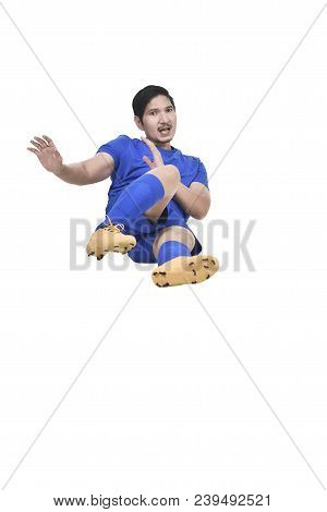 Images Of Asian Male Soccer Player Doing Sliding Tackle Isolated Over White Background