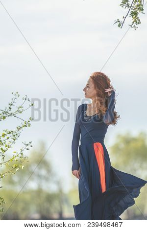Beautiful Cute Pretty Redhead Female Teenager In Long Romantic Dark Blue Dress At The River In The S
