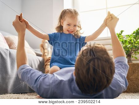 Happy loving family. Daddy and his daughter child girl playing together. Father's day concept.