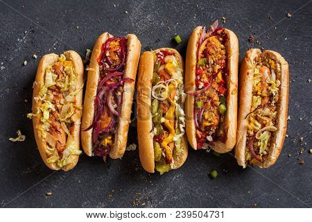 Hot Dogs With A Sausage On A Fresh Rolls Garnished With Mustard And Ketchup And Served With Differen