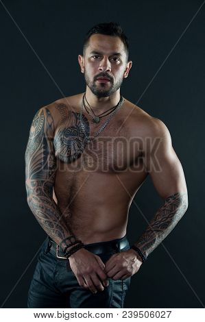 Bearded Man With Tattooed Body. Macho With Sexy Bare Torso In Jeans. Tattoo Model With Six Pack And