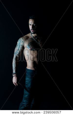 Sport Or Fitness And Bodycare. Bearded Man With Tattooed Body. Macho With Sexy Bare Torso In Jeans.
