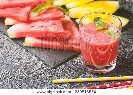 Glass Of Fresh Red Watermelon Juice With Slices Of Red And Yellow Watermelon. Healthy Eco Sweet Food
