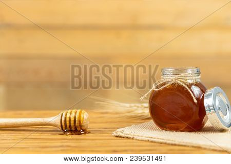 honey and honey comb with wooden stick
