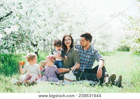 Happy Big Family Mom Dad And Children Daughters And Son Having Fun Outdoor In Park Smiling And Laugh
