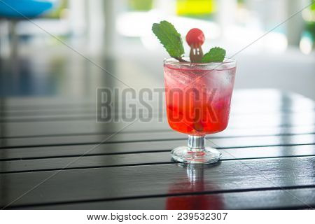 Summer Iced Fresh Drink Punch Juice With Ice, Cherry And Mint On Table In Swimming Pool