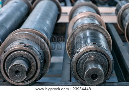 Close up steel axle shafts in factory. Industrial concept poster