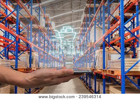 Online Shopping, Ecommerce Over Internet Concept : Shopping Cart Logo On A Smartphone With Warehouse