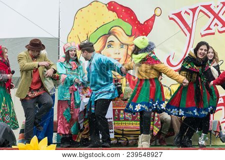 Tiraspol, Moldova - February 18: A Group Of Actors Dances On Stage At The Carnival Of Pancake Week.
