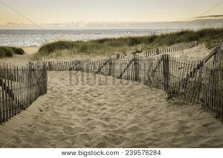 Aged looking image with wooden fence and Atlantic ocean early morning near Provincetown in Cape Cod , Massachussets, USA