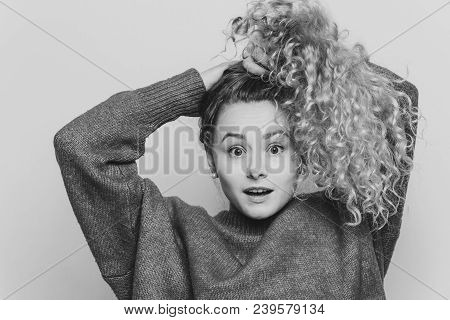 Emotional Surprised Female Strares At Camera With Unexpected Look, Keeps Hair In Pony Tail, Expresse