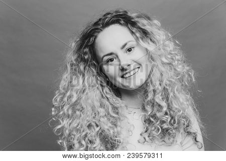 Happy Delighted Good Loking Female With Positive Expression, Curly Bushy Hair, Smiles Joyfully At Ca
