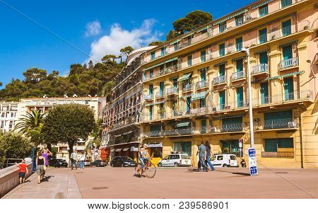 Nice, France - October 13, 2009: Typical Colorful Buildings And Lush Nature In Nice