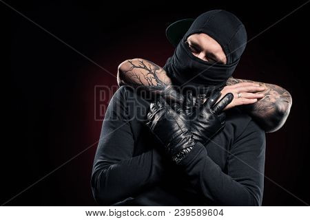 Man Chocking Burglar Dressed In Black Clothes And Balaclava