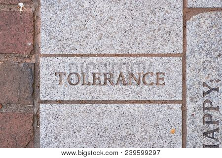 The Word Tolerance On A Motivational Brick Sidewalk Made Of Concrete And Mortar.
