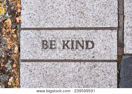 The Words Be Kind On A Motivational Brick Sidewalk Made Of Concrete And Mortar.