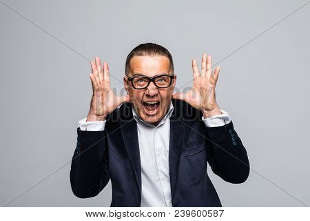 Happy Young Man In Formalwear Shouting While Looking At Camera And Standing Isolated On White Backgr