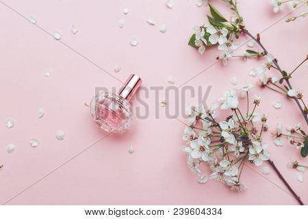 Women's Hand Spray Perfume. Flower Arrangement. Flowers, Fragrance, Perfume On Pink Background