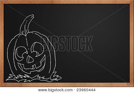 Halloween Pumpkin Smiling On A Black Chalkboard