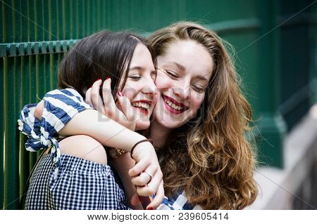 Two lovely girls having fun on the street. Bff conception.