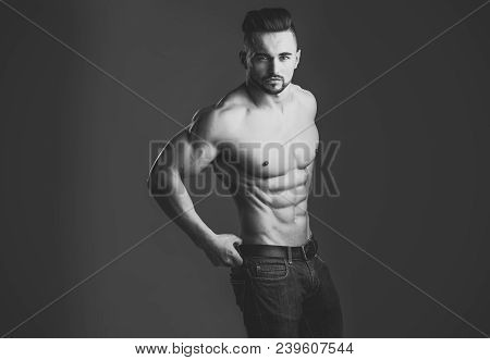 Dieting And Fitness. Athletic Bodybuilder Man On Grey Background. Coach Sportsman With Bare Chest In